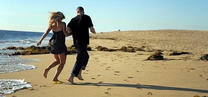 Couple on a Cheap Beach Honeymoon